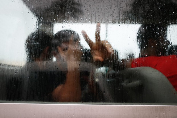 Asylum seekers on a bus after a visit into town on Manus Island.